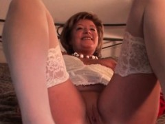 Stockinged mature rubs and dildos pussy