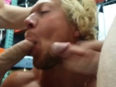 Surfer on his knee giving double blowjob