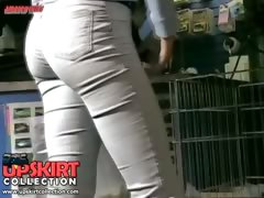 Cute amateur girls in tight jeans are walking paying no