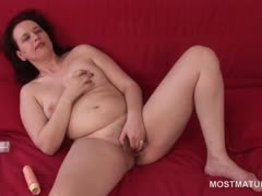 Excited naked mature pleasing her pussy with fingers and toy