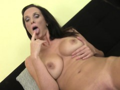 Big titted brunette MILF fingering her pussy