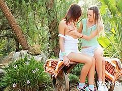 Sweet Ivana playing with Natasha Shys tiny boobs outdoor