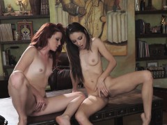 Elle lays on the desk with Celeste's wet pussy