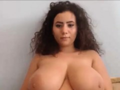 Teen with curly hair playing with natural big tit