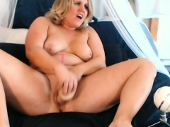 fat blonde babe fucks herself with a huge dildo