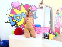 In a yellow mesh bodysuit, big-booty blonde Kelsi Monroe is