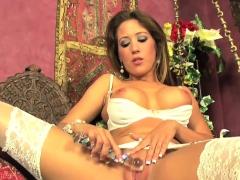Capri fucks her pussy in some hot white lingerie