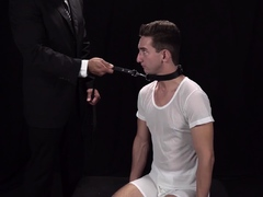 Twink gets whipped by a leather strap by mature Bishop